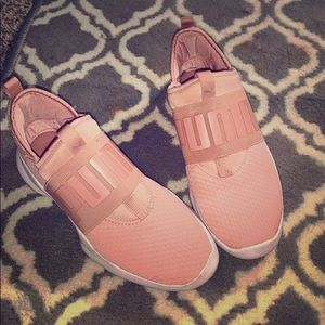 Pink Pumas by Rihanna in a mauve color
